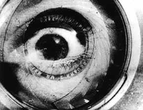 Double exposure of a camera lens and a human eye, black and white.