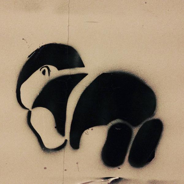 Stencils like this show that the position of Aylan's body has become iconic in itself.